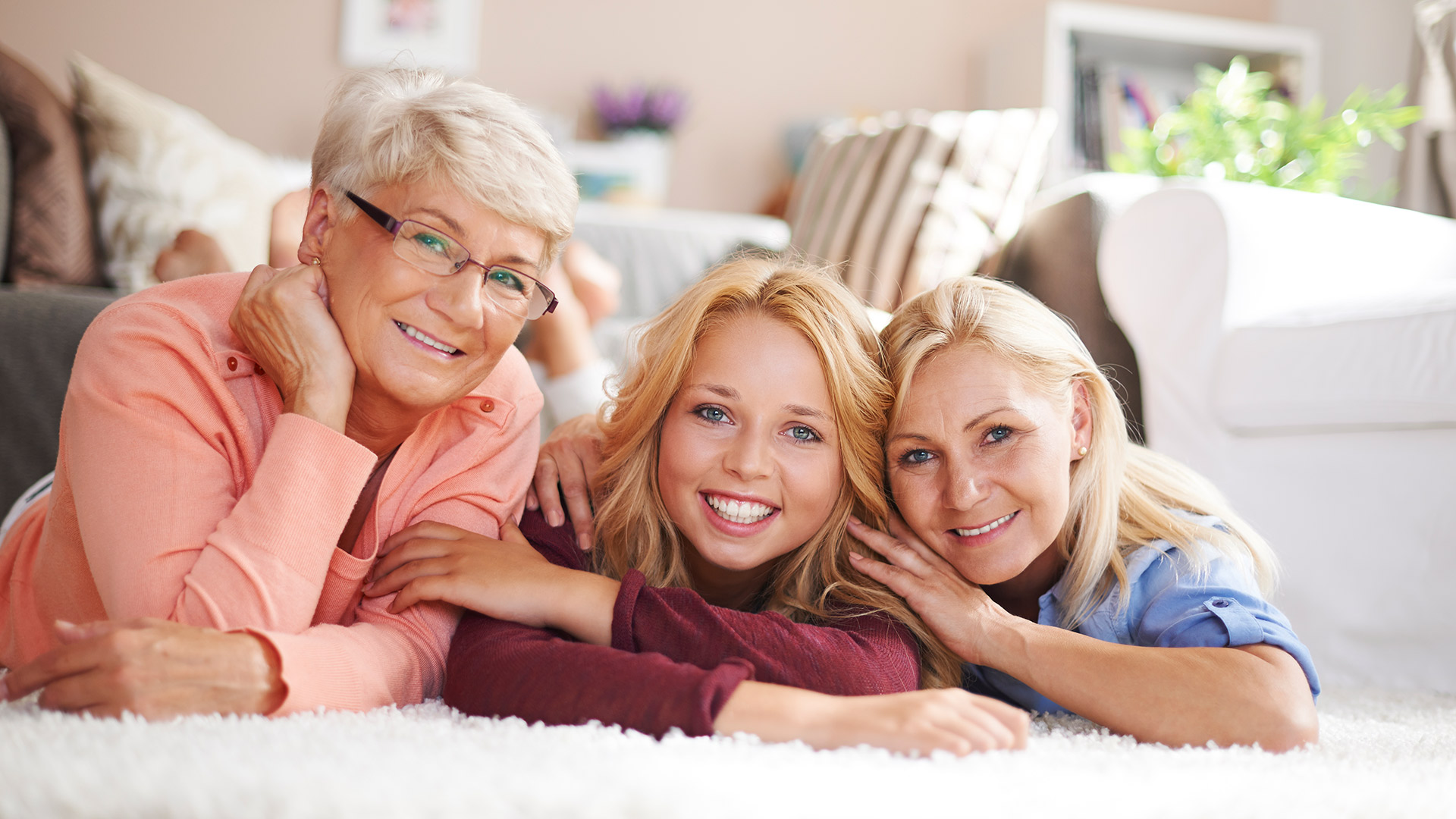Happy teen girl with her mother and grandmother